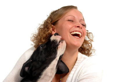 woman laughing with puppy